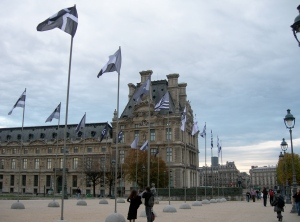 Musee du Louvre and the grey flags
