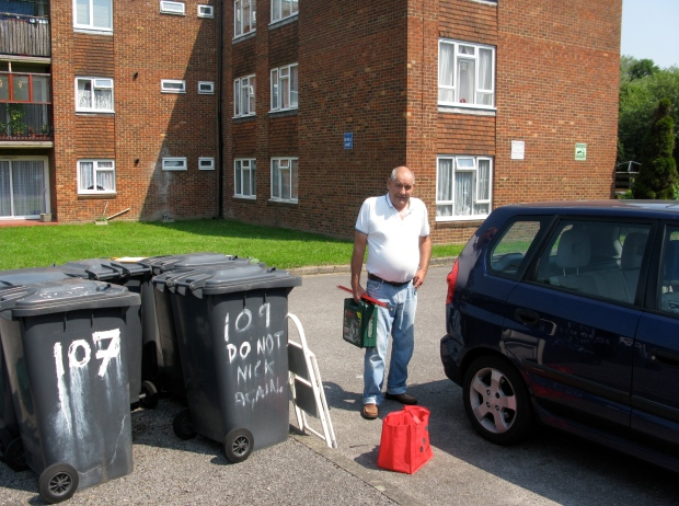 Repair man with bins