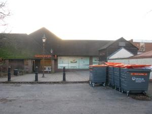 Town centre: Supermarket with wheelie bins