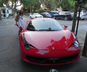 Jojo with a red Ferrari